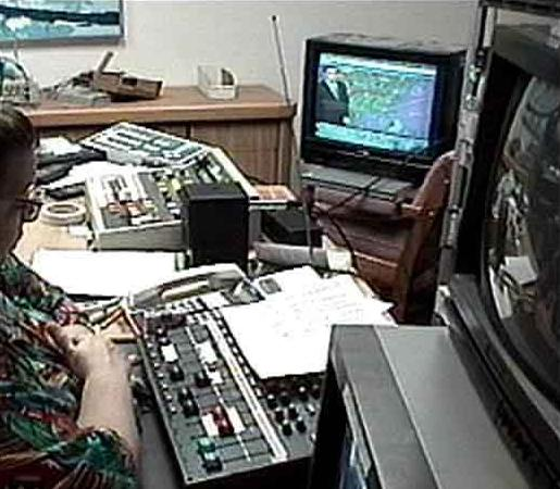 Close-up view of the Emergency Master Control.  Equipment included an audio mixer, 2 DVCPRO decks, a Pictaurus DVE, a Grass Valley 100 switcher, multiple broadcast monitors and cables, general broadcast gear, a DSS dish to receive a feed from The Weather Channel, and a NOAA Weather radio.